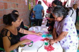 Moradores do bairro Zumbi recebem ação social do gabinete itinerante de João Luiz
